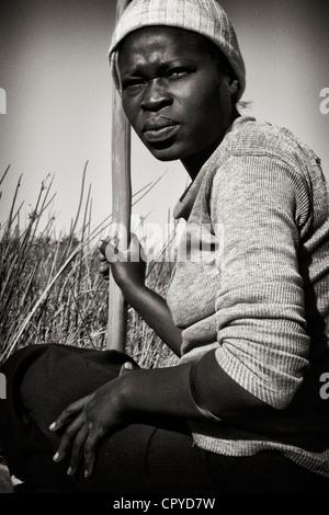 Bushman resting in the Okavango Delta, Botswana - Stock Image
