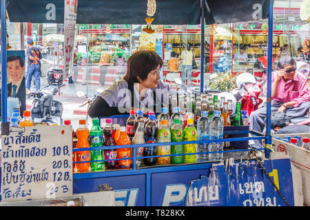 Bangkok, Thailand - April 21st 2011: Woman behind her mobile drinks stall in Chinatown. People often buy drinks as it is so hot. - Stock Image