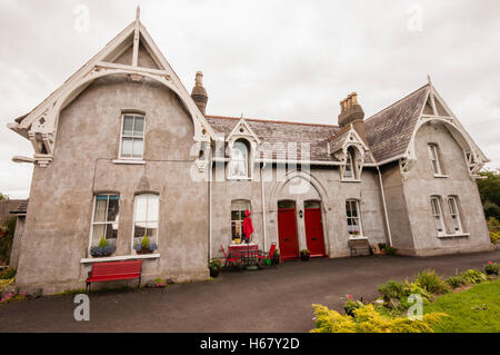 Charles Shiel's Institution Almshouses, Carrickfergus, built in 1868 as a charity for 'destitute women'. - Stock Image