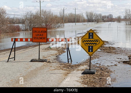 Quebec,Canada. A flooded road in Saint-Barthelemy caused by the Spring thaw. - Stock Image