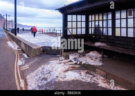 Sidmouth, Devon, UK. 13th Dec 2018 Sea foam covers the Esplanade at Sidmouth, brought on by gale force winds and stormy seas. Photo Central/Alamy Live News - Stock Image