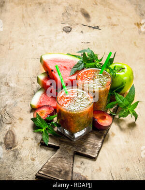 Fruit smoothie with watermelon. On wooden background. - Stock Image