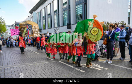 Brighton UK 4th May 2019 - Thousands of schoolchildren , teachers and parents take part in the annual Brighton Festival Children's Parade through the city which has the theme 'Folk Tales from Around the World' . Organised by the Same Sky arts group the parade traditionally kicks off the 3 week arts festival with this years guest director being the singer songwriter Rokia Traore . Credit : Simon Dack / Alamy Live News - Stock Image
