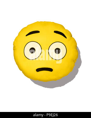A colourful shot of the startled or surprised Emoji cushion. - Stock Image