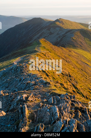 Looking towards Whiteside from the summit of Hopegill Head at sunset in the Lake District - Stock Image