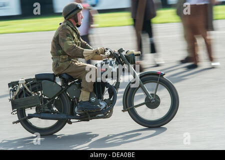 Chichester, West Sussex, UK. 14th Sep, 2013. Goodwood Revival. Goodwood Racing Circuit, West Sussex - Saturday 14th September. A vintage army motorcycle and driver in motion during a parade lap on the track. Credit:  MeonStock/Alamy Live News - Stock Image