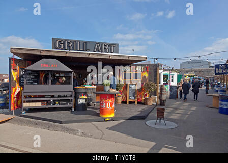 The Grill Art stall at the Reffen Street Food on Refshaleøen, Copenhagen, Denmark, on the season opening day in spring, warm and sunny from a blue sky - Stock Image