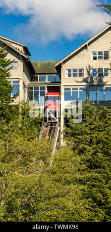Sept. 17, 2018 - Ketchikan, AK: Cape Fox Hill Lodge red tram car ascending rail track at top of ride. - Stock Image
