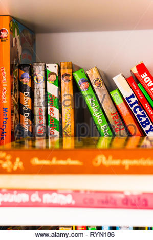Poznan, Poland - November 18, 2018: Row of colorful child books in Polish on a shelf. - Stock Image
