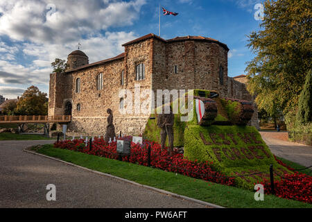 World War One flower display of an old tank at Colchester Castle, Essex - Stock Image