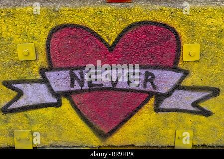Buiksloterham, Amsterdam, Netherlands,  2018, Ferry Terminal , Graffiti Zone Detail. Red heart pink banner word never - Stock Image