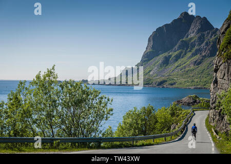 Female cyclist in Vesteralen, Norway. - Stock Image