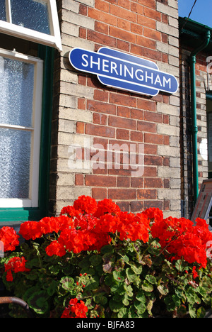 Station sign and flowers at Sheringham Station, North Norfolk Railway - Stock Image