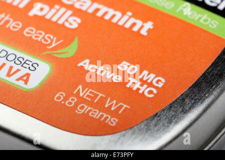 Close-up on the words 50 MG Active THC on a tin of 'Sublime Spearmint Chill Pills,' a form of edible marijuana - Stock Image