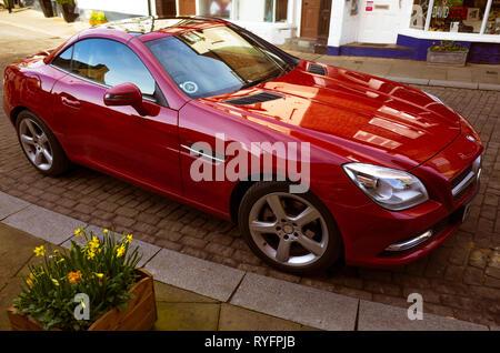 Red Mercedes Benz SLK Roadster soprts car in North Yorkshire in Spring - Stock Image