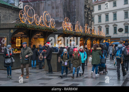 Christmas Market opposite St Stephen's Cathedral at St Stephen's square, Vienna, Austria. - Stock Image
