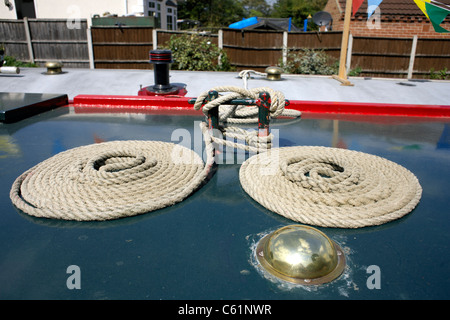 Two ropes coiled neatly on the roof of a narrowboat, on the Trent and Mersey Canal at Burton on Trent, Staffordshire, - Stock Image