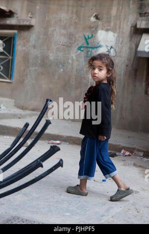 Girl walking in the Palestinian camp of Chatila, Beirut, Lebanon - Stock Image