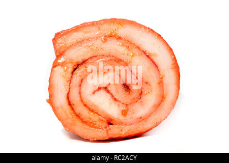 Slavic cured rolled pork with paprika on a white background - Stock Image
