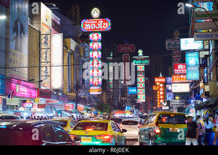 Night shot of Chinatown district in Bangkok, Thailand, with heavy traffic and neon signs. - Stock Image