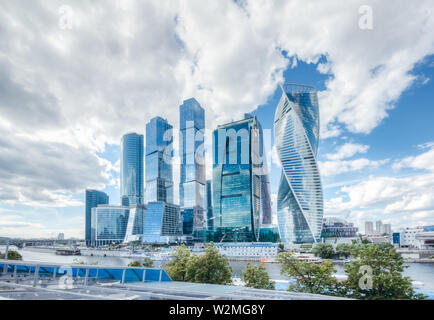 Business center of Moscow city under a blue sky with cumulus clouds on a summer day - Stock Image