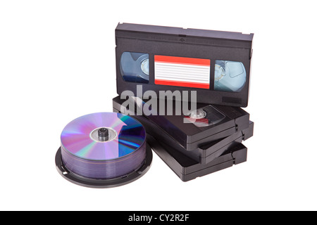 Old Video Cassette tapes with a DVD disc isolated on white background - Stock Image