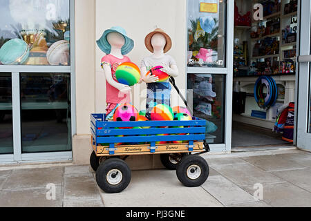 Retail store exterior display of colorful children's clothing and beach toys on front sidewalk in Seaside Florida, USA. - Stock Image