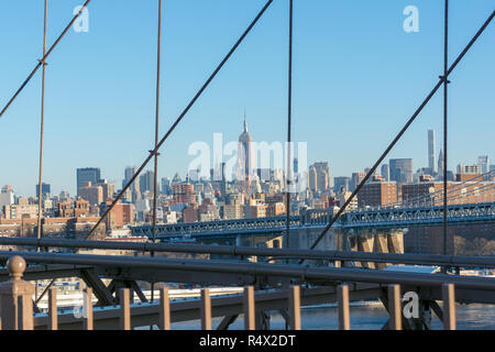 View of Manhattan from Brooklyn Bridge, New York City on a clear and sunny winter day - Stock Image