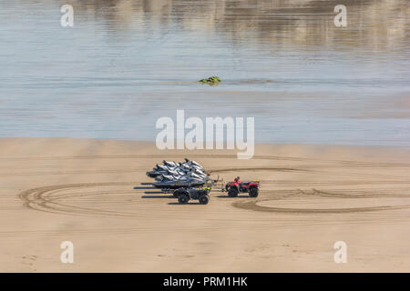 Jet Ski rides and hires at Newquay, Cornwall. Loaded Jet Ski trailers on the beach. - Stock Image
