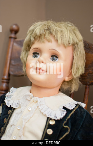Antique child's doll, Lincoln County Museum, Davenport, Washington State, USA. - Stock Image