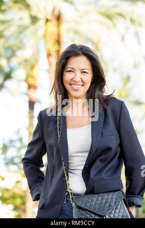 Portrait of an Asian woman smiling - Stock Image