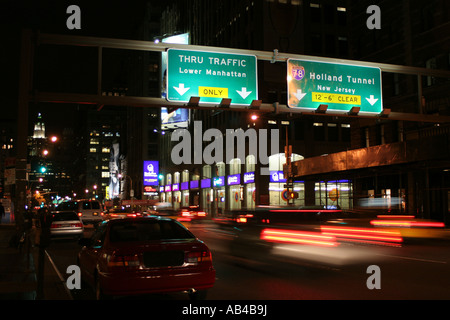 Manhattan street signs directing traffic around the Holland Tunnel entrance, New York, NY, USA - Stock Image
