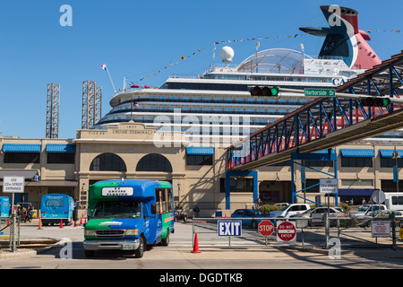 Shuttle bus disembarking passengers from Carnival Magic cruise ship at Galveston Texas USA - Stock Image