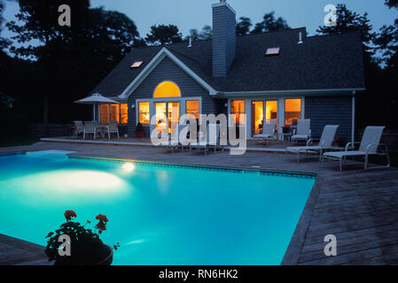 Home with Swimming Pool at Dusk, USA - Stock Image