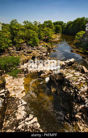 UK, Yorkshire, Wharfedale, Linton Falls, exposed rocky riverbed during dry summer weather - Stock Image
