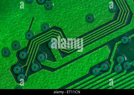 Macro-photo of printed circuit wiring for a PC motherboard. Wiring inside computer. - Stock Image