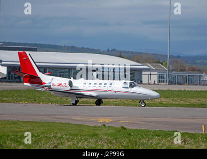 A Cessna 550 Citation Bravo preparing to depart Inverness Airport in the Scottish Highlands, UK. - Stock Image
