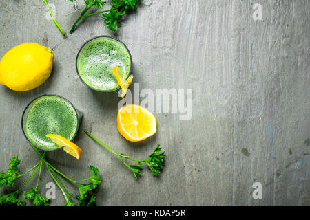 Healthy smoothie with lemon and parsley. On rustic background. - Stock Image