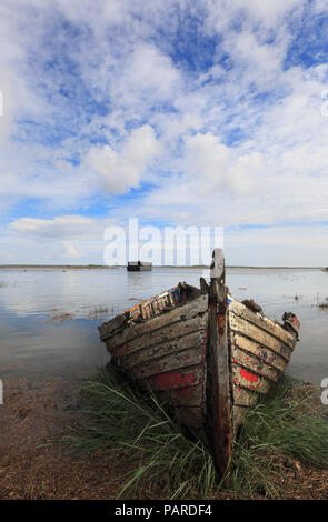 An old wooden boat at Burnham Deepdale on the Norfolk coast. - Stock Image