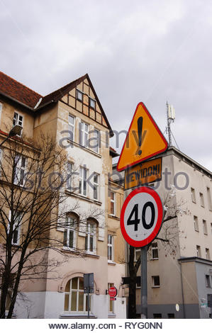 Poznan, Poland - March 8, 2019: Speed limit sign showing number forty on the Slowackiego street with apartment buildings. - Stock Image
