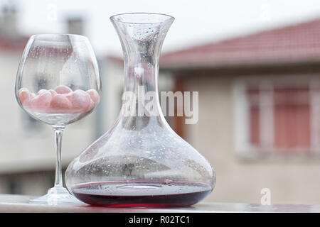 Still life with breath red wine bottle and glass - Stock Image