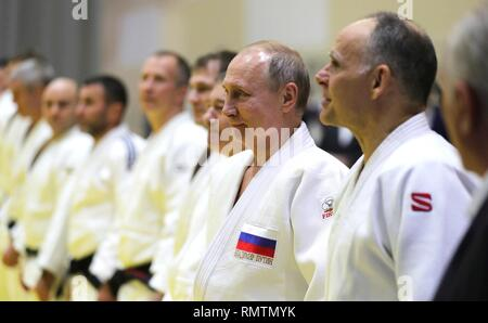 Russian President Vladimir Putin chats with the head coach of the Russian judo team Ezio Gamba, right, during judo practice at the Yug-Sport Training Centre February 14, 2019 in Sochi, Russia. - Stock Image