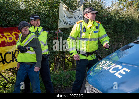 Little Plumpton, near Blackpool, UK. 24th September 2018. Anti Fracking Demonstration at the Cuadrilla Preston New Road shale gas site. Transport that arrived at the Cuadrilla site in the early hours was challenged by protestors as it left. It was believed one protestor was arrested. Credit: Stephen Bell/Alamy Live News. - Stock Image