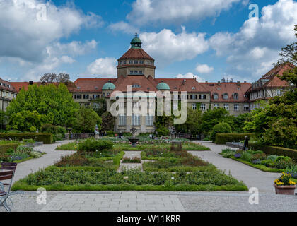 Munich, Bavaria, Germany - May 23, 2019.  München-Nymphenburg Botanical garden on a spring day featuring the main building  and the garden - Stock Image