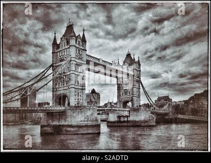 An Antique & Grunge effect picture of Tower Bridge which spans the River Thames in London, England. This Grade 1 Listed Building was constructed in the 19th Century & is a Tourist highlight. - Stock Image
