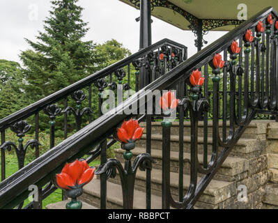 Decorative wrought iron railings with a floral motif on the bandstand in the Pavilion Gardens, Buxton, UK - Stock Image