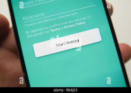 Image of the Talkspace app on a smartphone , start therapy button - Stock Image