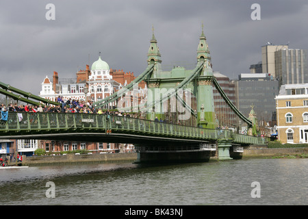 Spectators Waiting for the Head of the River Race on the River Thames at Hammersmith Bridge. - Stock Image