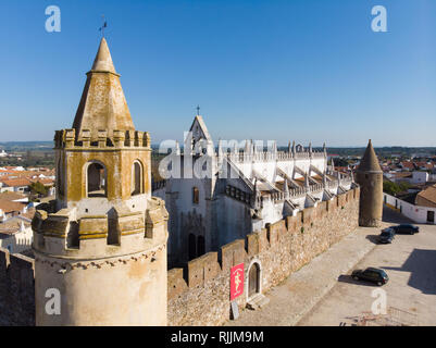 The town and castle of Viana do Alentejo in Southern Portugal against a deep blue sky - Stock Image