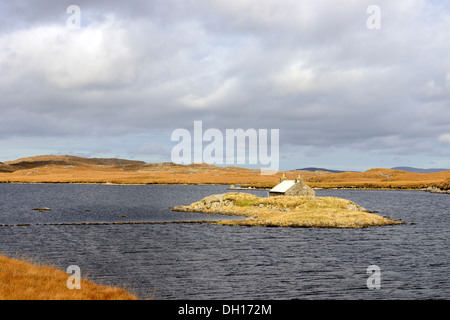 Bothy or Shieling on a small island in Loch Faoghail an Tuim - Stock Image
